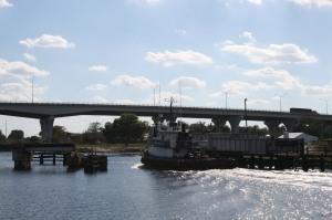 Working boat leaving Moore Haven Lock