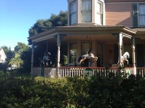 Carousel horses on a verandah