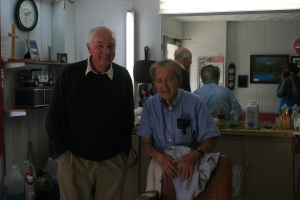 Ian with Mr Robert Mitchell in his barber's shop, Columbia, NC